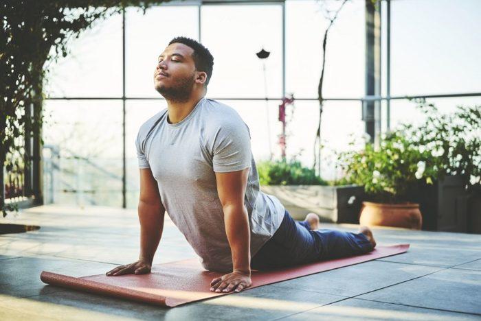 young-man-practicing-yoga